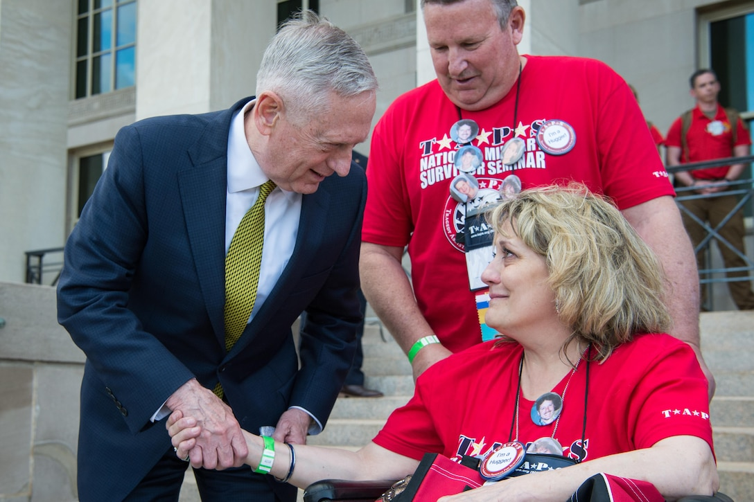 Defense Secretary Jim Mattis speaks with a member of the Tragedy Assistance Program for Survivors