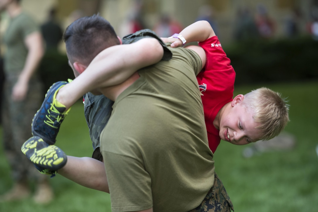 Seven-year-old Orion Clarkson tries to tackle Marine Cpl. Skylar Heidrich during a Marine martial arts demonstration