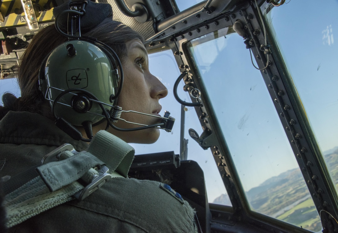 A U.S. Air Force 1st Special Operations Squadron pilot looks out the window of a U.S. Air Force MC-130H Combat Talon II during a formation flight with Royal New Zealand Air Force 40th Squadron, April 22, 2017 at RNZAF Base Woodbourne, New Zealand. Exercise Teak Net provided the opportunity at further developing interoperability with counterparts from the RNZAF through daily airborne operations to include low-level formation work and tactical operations on night vision goggles. (U.S. Air Force photo by Capt. Jessica Tait)
