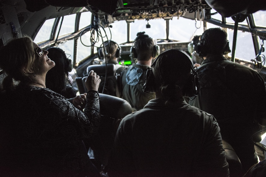 U.S. Embassy New Zealand staffers enjoy the view from the cockpit of an U.S. Air Force MC-130H Combat Talon II assigned to the 1st Special Operations Squadron during an observation flight, April 19, 2017 at Royal New Zealand Air Force Base Woodbourne, New Zealand. U.S. Embassy staffers came down during Exercise Teak Net to observe first-hand the training being conducted with RNZAF partners. (U.S. Air Force photo by Capt. Jessica Tait)