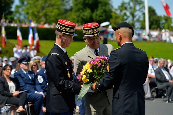French military officials receive a wreath from a U.S. Army representative during a Memorial Day ceremony on Lorraine American Cemetery and Memorial, France, May 28, 2017. 2017's ceremony was especially notable, because it marked 100 years since the U.S. entered the First World War. (U.S. Air Force photo by Airman 1st Class Joshua Magbanua)