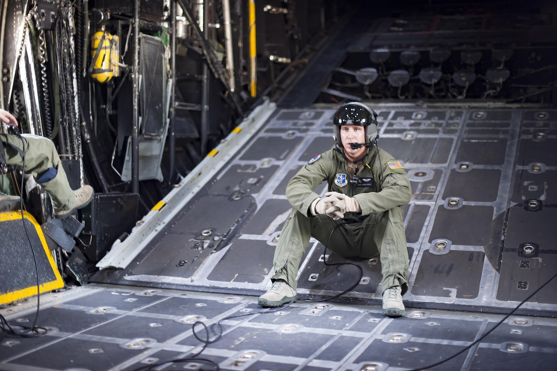 Staff Sgt. Aaron Foote, a loadmaster with the 129th Rescue Wing, out of Moffett Federal Airfield, Calif., talks to HC-130P/N Combat King during the National Salute to America's Heroes Air and Sea Show media day May 26, 2017, at Miami Beach, Fla. Top tier U.S. military assets have assembled in Miami to showcase air superiority while honoring those who have made the ultimate sacrifice during the Memorial Day weekend. The 129th RQW will team up with two HH-60G Pave Hawk and four A-10 Thunderbolt II aircraft from the 920th Rescue Wing and the 442d Fighter Wing respectively, to headline the airshow by demonstrating combat-search-and-rescue capabilities. (U.S. Air Force photo/Staff Sgt. Jared Trimarchi)