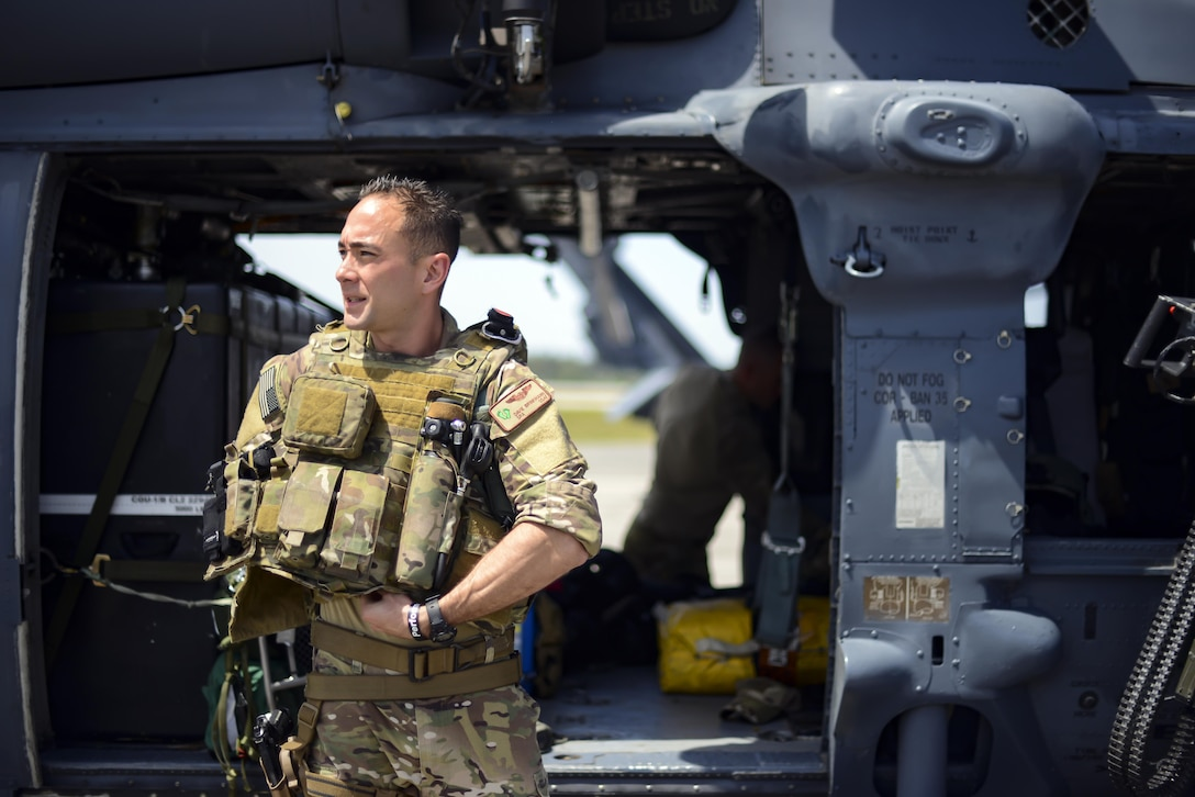 Senior Airman Davie Brinkmann, a special mission's aviator from the 920th Rescue Wing, preps his gear in front of an HH-60G Pave Hawk during the National Salute to America's Heroes Air and Sea Show media day May 26, 2017, at Miami Beach, Fla. Top tier U.S. military assets have assembled in Miami to showcase air superiority while honoring those who have made the ultimate sacrifice during the Memorial Day weekend. The 920th Rescue Wing, the Air Force Reserve's only rescue wing, will headline the airshow by demonstrating combat-search-and-rescue capabilities by teaming up with a HC-130P/N Combat King and four A-10 Thunderbolt II aircraft. (U.S. Air Force photo/Staff Sgt. Jared Trimarchi)
