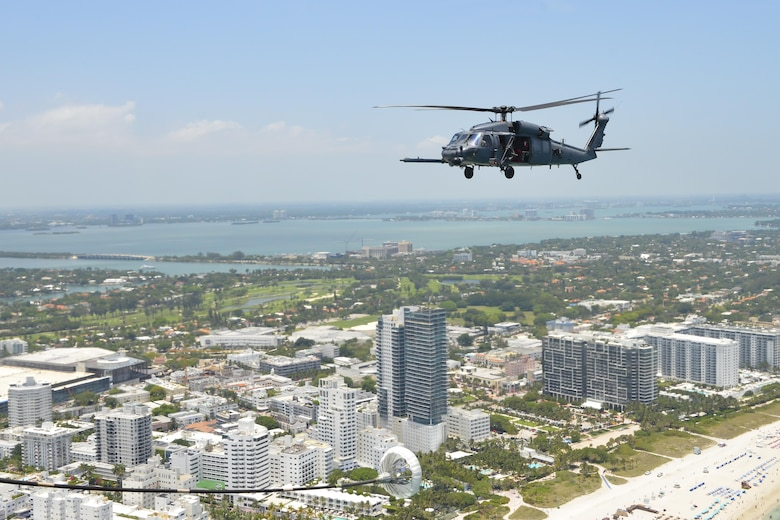 Aircrew from the 920th Rescue Wing out of Patrick Air Force Base, Fla., fly an HH-60G Pave Hawk helicopter during the National Salute to America's Heroes Air and Sea Show, May 26, 2017, at Miami Beach, Fla. Top tier U.S. military assets assembled in Miami to showcase air superiority while honoring those who have made the ultimate sacrifice during the Memorial Day weekend. The 920th Rescue Wing, the Air Force Reserve's only rescue wing, headlined the airshow, demonstrating combat-search-and-rescue capabilities, by teaming up with a HC-130P/N Combat King and four A-10 Thunderbolt II aircraft. (U.S. Air Force photo/Senior Airman Brandon Kalloo Sanes)