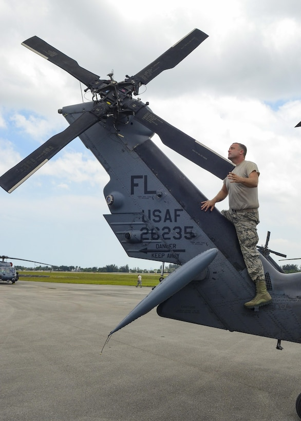 Staff Sgt. Nathan Weiss, crew chief from the 920th Rescue Wing, works on an HH-60G Pave Hawk helicopter near Miami Beach during the National Salute to America's Heroes Air and Sea Show media day May 26, 2017. Top tier U.S. military assets have assembled in Miami to showcase air superiority while honoring those who have made the ultimate sacrifice during the Memorial Day weekend. The 920th Rescue Wing, the Air Force Reserve's only rescue wing, will headline the airshow by demonstrating combat-search-and-rescue capabilities by teaming up with a HC-130P/N Combat King and four A-10 Thunderbolt II aircraft. (U.S. Air Force photo by Senior Airman Brandon Kalloo Sanes)