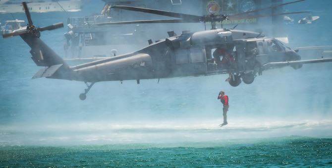 A Pararescueman from the 920th Rescue Wing out of Patrick Air Force Base, Fla., enters the water from an HH-60G Pave Hawk helicopter during the National Salute to America's Heroes Air and Sea Show, May 27, 2017, at Miami Beach, Fla. Top tier U.S. military assets assembled in Miami to showcase air superiority while honoring those who have made the ultimate sacrifice during the Memorial Day weekend. The 920th Rescue Wing, the Air Force Reserve's only rescue wing, headlined the airshow, demonstrating combat-search-and-rescue capabilities, by teaming up with a HC-130P/N Combat King and four A-10 Thunderbolt II aircraft. (U.S. Air Force photo/Senior Airman Brandon Kalloo Sanes)