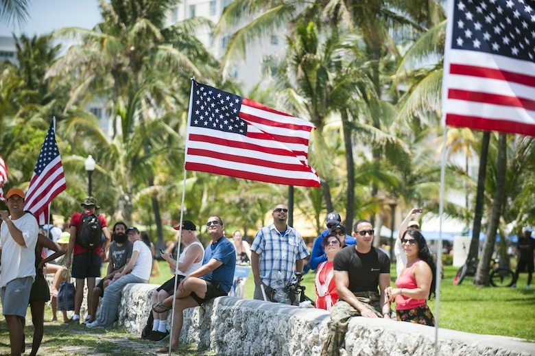 Spectators view an aerial demonstration during the National Salute to America's Heroes Air and Sea Show, May 28, 2017, at Miami Beach, Fla. Top tier U.S. military assets assembled in Miami to showcase air superiority while honoring those who have made the ultimate sacrifice during the Memorial Day weekend. (U.S. Air Force photo/Staff Sgt. Jared Trimarchi)