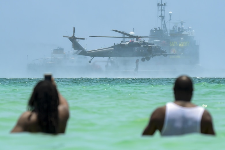 Spectators view an aerial demonstration during the National Salute to America's Heroes Air and Sea Show, May 28, 2017, at Miami Beach, Fla. Top tier U.S. military assets assembled in Miami to showcase air superiority while honoring those who have made the ultimate sacrifice during the Memorial Day weekend. (U.S. Air Force photo/Senior Airman Brandon Kalloo Sanes)