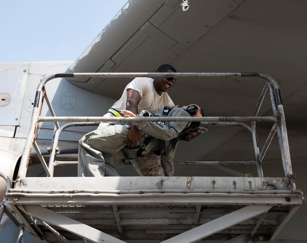 U.S. Air Force Staff Sgt. Henry Thomas III, crew chief assigned to the 728th Air Mobility Squadron, demonstrates positive control of a training dummy during fall and rescue training May 25, 2017, at Incirlik Air Base, Turkey. Maintenance and aerial port personnel sharpen their fall and rescue skills in the event that someone falls. (U.S. Air Force photo by Senior Airman Jasmonet D. Jackson)