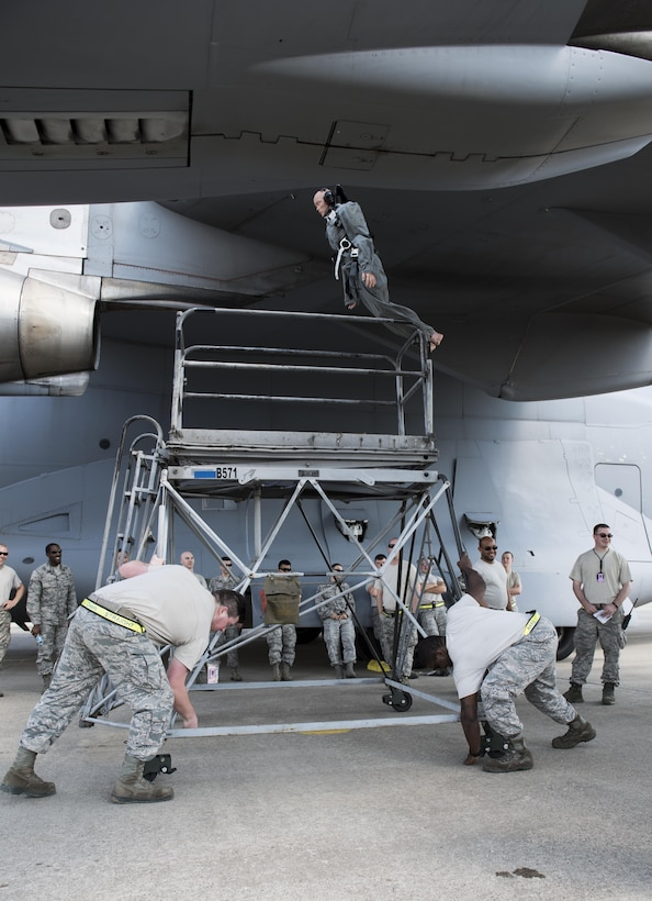 U.S. Air Force Senior Airman Logan Blauvelt (left), and Staff Sgt. Henry Thomas III, crew chiefs assigned to the 728th Air Mobility Squadron, lock the wheels on a B-5 maintenance platform during fall and rescue training May 25, 2017, at Incirlik Air Base, Turkey. A B-5 maintenance platform is one of the many pieces of equipment that is used to rescue someone that is hanging from the tail or wing of an aircraft. (U.S. Air Force photo by Senior Airman Jasmonet D. Jackson)