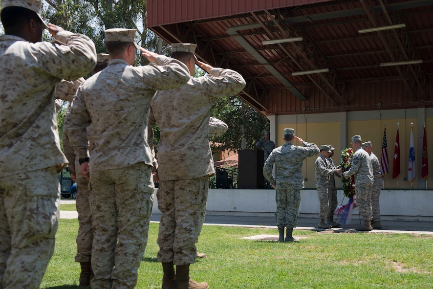 Members of the 39th Air Base Wing, salute while a wreath is laid during a Memorial Day Ceremony May 26, 2017, at Incirlik Air Base, Turkey. The laying of the wreath is done in memory of United States military members who paid the ultimate sacrifice. This marked the first joint service ceremony at Incirlik. (U.S. Air Force photo by Airman 1st Class Devin M. Rumbaugh)