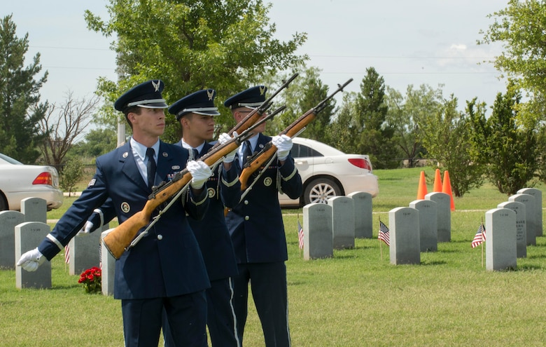 Members from the Dyess Air Force Base Honor Guard preform a firing party at the Texas State Veterans Cemetery, Abilene, Texas, May 29, 2017. The firing party is used to honor fallen service members by firing 3 volleys into the air over the service member's head. (U.S. Air Force photo by Senior Airman Austin Mayfield)