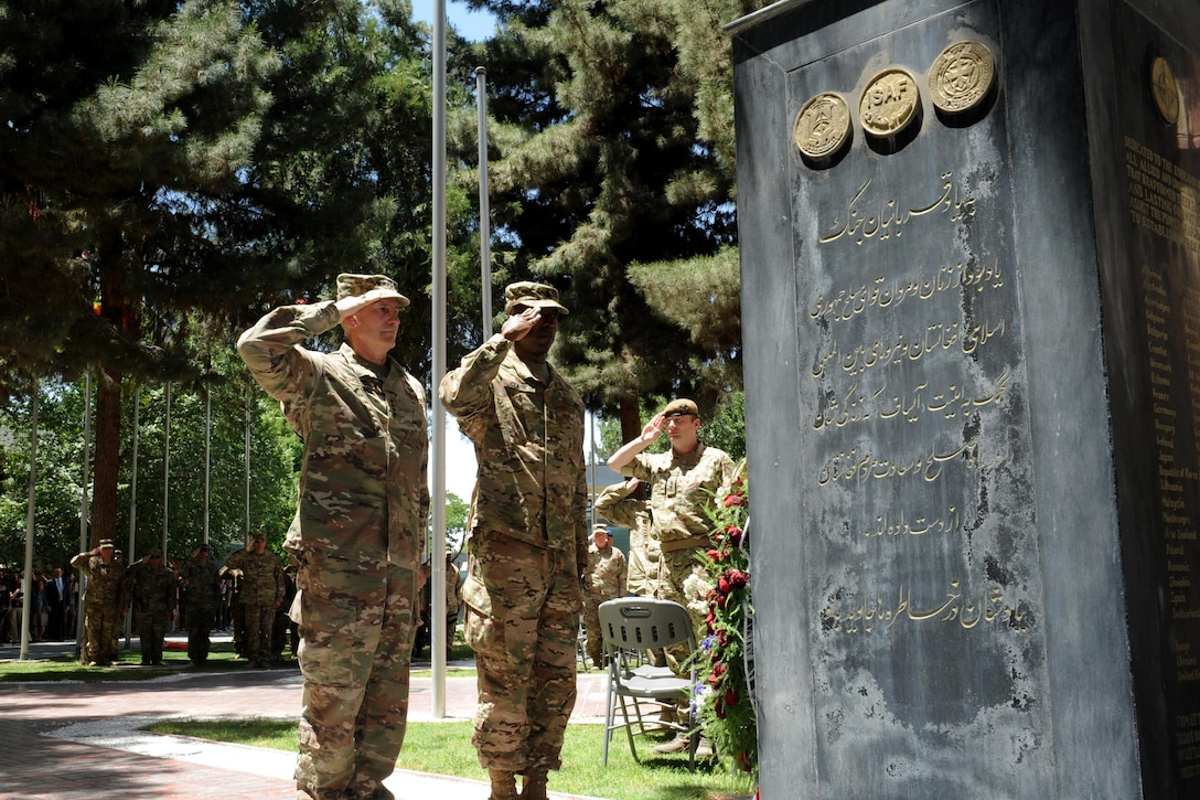 Army Gen. John Nicholson, commander of Resolute Support, pays his respects to service members who made the ultimate sacrifice in Afghanistan