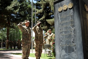 Army Gen. John Nicholson, commander of Resolute Support, pays his respects to service members who made the ultimate sacrifice in Afghanistan during a Memorial Day ceremony in Kabul, Afghanistan.