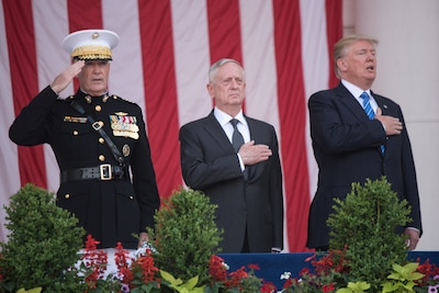 President Donald J. Trump, right, Defense Secretary Jim Mattis and Marine Corps Gen. Joe Dunford, chairman of the Joint Chiefs of Staff, render honors during the 149th annual DoD National Memorial Day Observance at Arlington National Cemetery in Virginia, May 29, 2017. DoD Photo by Army Sgt. James K. McCann