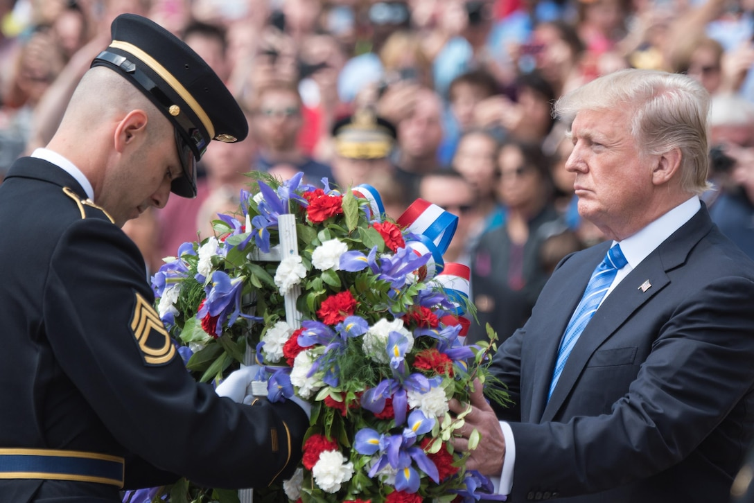 President Donald J. Trump lays a wreath at the Tomb of the Unknowns at Arlington National Cemetery in Arlington, Va.