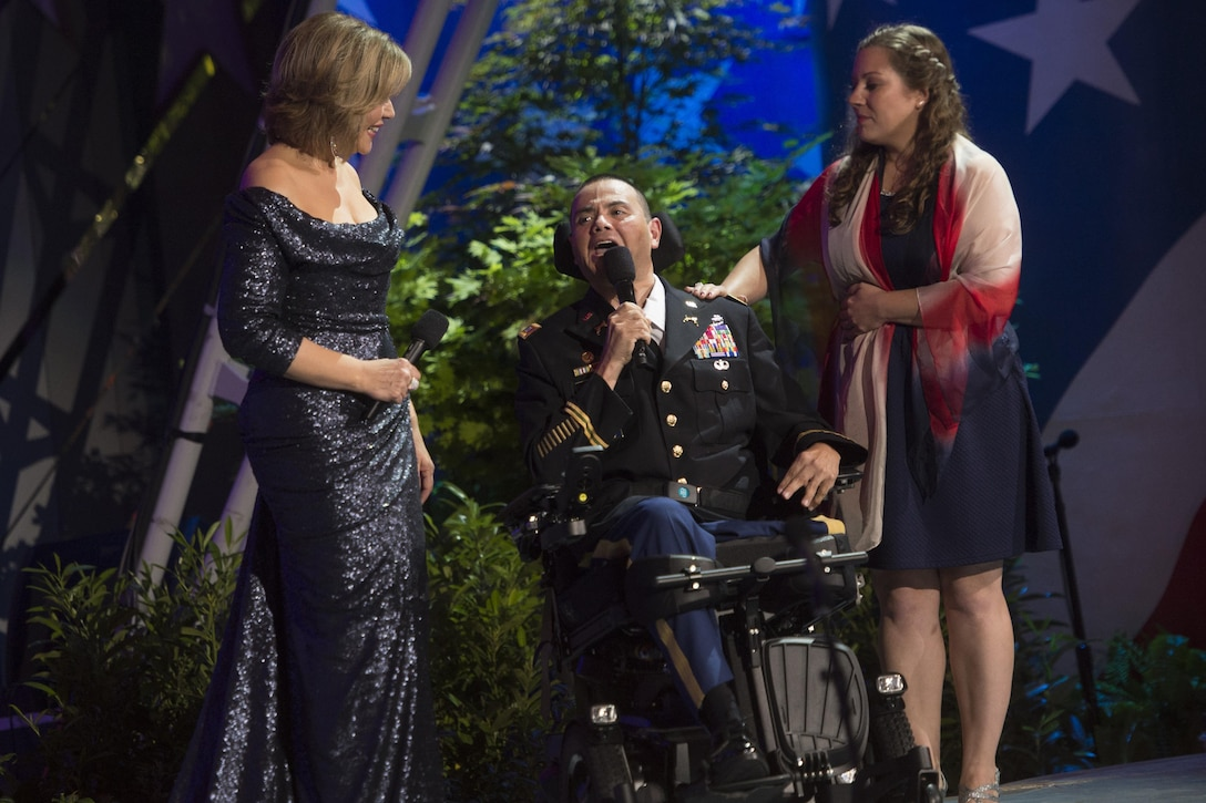 Army Capt. Luis Avila, a military policeman severely injured after an IED explosion, performs alongside his music therapist Rebecca Vaudeuil and opera singer Renée Fleming