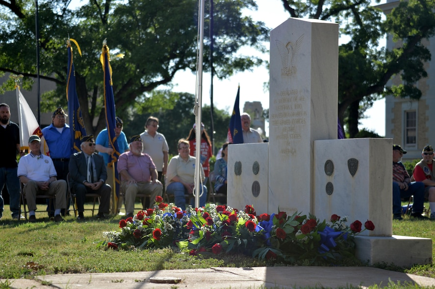 Flowers and wreaths adorn the veteran memorial during the Memorial Day ceremony at the Tom Green County Courthouse in San Angelo, Texas, May 29, 2017. The ceremony paid tribute to those who have lost their lives in all branches of the military. (U.S. Air Force photo by Airman 1st Class Randall Moose/Released)