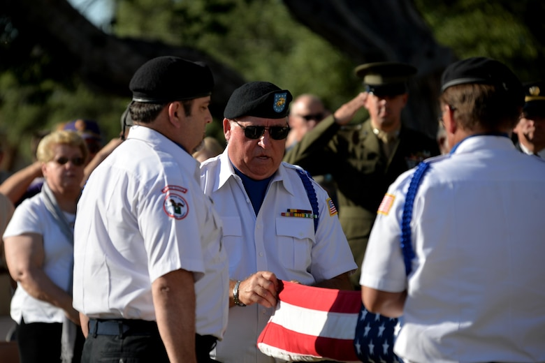 Members of the All Veterans Council fold the American flag during the Memorial Day Commemoration ceremony at the Tom Green County Courthouse, May 29, 2017. The All Veterans Council then presented the flag to one of the other veterans in attendance. (U.S. Air Force photo by Airman 1st Class Randall Moose/Released)