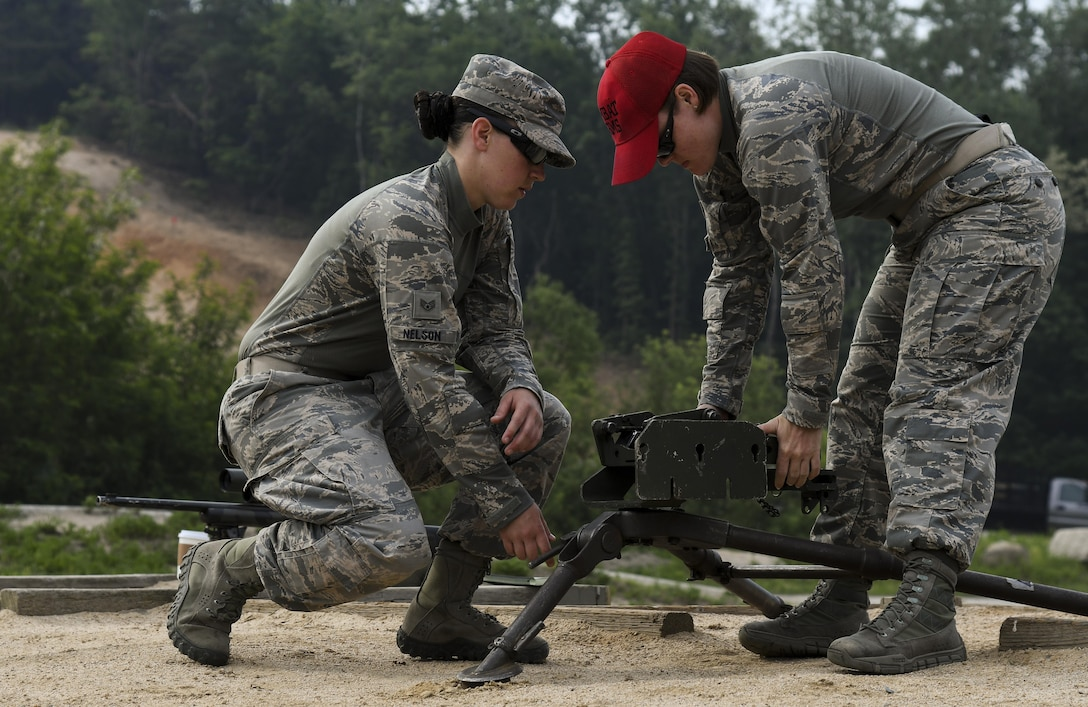 U.S. Air Force Staff Sgt. Catherine Nelson, 8th Security Forces Squadron Armory NCO in charge, and Staff Sgt. Kayla Hahn, 8th SFS Combat Arms instructor, set up an M2 machine gun during a weapons qualification training at Camp Rodriguez, Republic of Korea, May 23, 2017. Defenders from both the 51st and 8th SFSs participated in the training together to ensure both teams are ready to employ weapons systems at a moment's notice. (U.S. Air Force photo by Airman 1st Class Gwendalyn Smith)