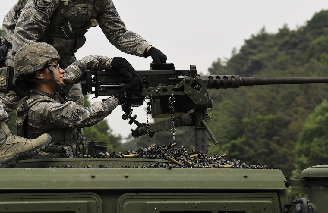 U.S. Air Force Airman 1st Class Jocelyn Fonseca, 8th Security Forces Squadron defender, charges the M2 machine gun during a weapons qualification training at Camp Rodriguez, Republic of Korea, May 23, 2017. Defenders from both the 51st and 8th SFSs participated in the training together to ensure both teams are ready to employ weapons systems at a moment's notice. (U.S. Air Force photo by Airman 1st Class Gwendalyn Smith)