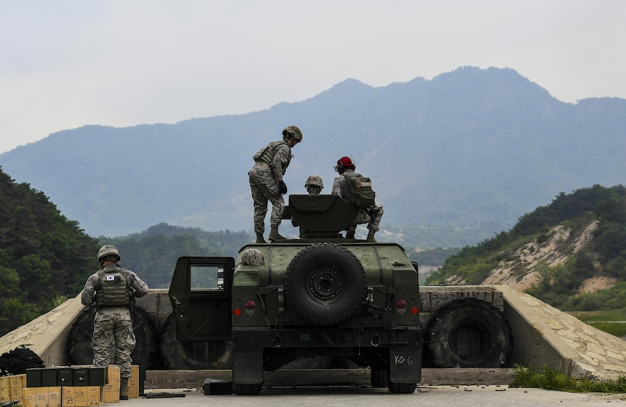 Defenders from the 51st and 8th Security Forces Squadrons participate in weapons training at Camp Rodriguez, Republic of Korea, May 23, 2017. During the training, Defenders qualified on the MK-19 grenade launcher, M2 machine gun and the M24 sniper rifle. (U.S. Air Force photo by Airman 1st Class Gwendalyn Smith)