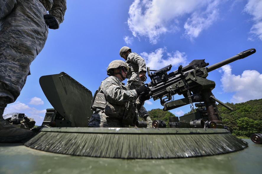 U.S. Air Force Airman Destri Snow, 51st Security Forces Squadron defender, fires an MK-19 grenade launcher during a weapons qualification training at Camp Rodriguez, Republic of Korea, May 24, 2017. The training ensures that Defenders are vigilant and always ready to 'Fight Tonight.' (U.S. Air Force photo by Airman 1st Class Gwendalyn Smith)