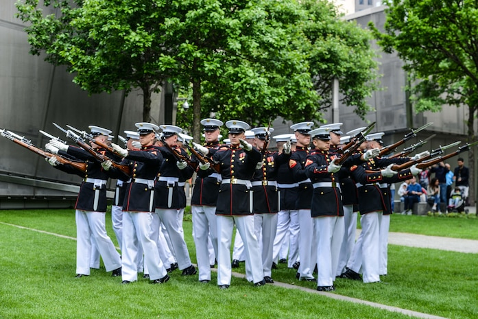 The Marine Corps Silent Drill Platoon performed for a crowd at the 9/11 Memorial Plaza in New York following the 2017 Freedom Run, May 28, 2017. Marines, Sailors, and Coast Guardsmen participated in the run to honor the lives lost in the 9/11 terrorist attacks.