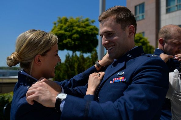 U.S. Air Force Capts. Haley Wilson, 603rd Air Operations Center strategy division officer, left, and Kevin Durr, Warrior Preparation Center program manager, pin their new ranks on each other during their promotion ceremony on Ramstein Air Base, Germany, May 26, 2017. The ceremony was presided over by Lt. Gen. Richard M. Clark, 3rd Air Force commander. (U.S. Air Force photo by Airman 1st Class Joshua Magbanua)