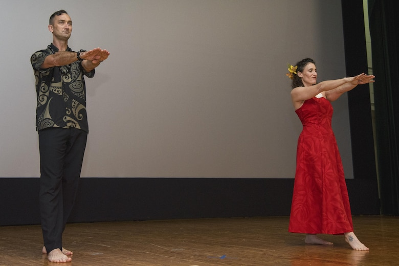 11th Security Forces Group commander, Col. Troy Roberts and his wife, Jenny Roberts, perform a hula dance during the Asian American and Pacific Islander Heritage Month Culture Show at Joint Base Andrews, Md., May 24, 2017. The month-long observance was signed into law from a week to a month by the 41st U.S. President, George H.W. Bush, in 1992, and from that year forward, congress permanently designated May as AAPIHM. (U.S. Air Force photo by Airman 1st Class Valentina Lopez)