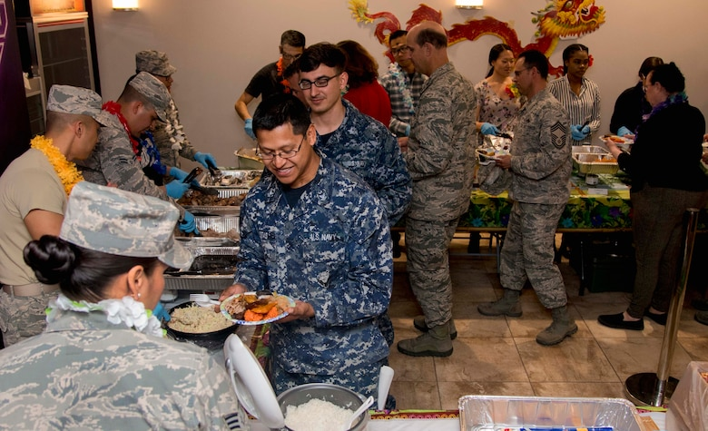 Base members attend the Asian American and Pacific Islander Heritage Month Culture Show at Joint Base Andrews, Md., May 24, 2017. Event attendees got the opportunity to learn about and taste dishes from Guam, Philippines, India and Japan.  (U.S. Air Force photo by Airman 1st Class Valentina Lopez)