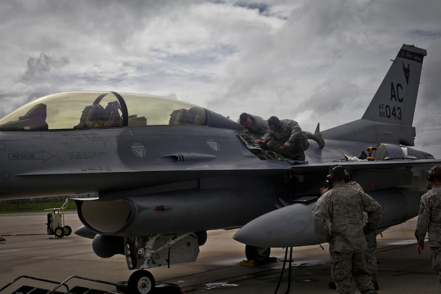 A New Jersey National Guard F-16D Fighting Falcon from the 177th Fighter Wing is worked on prior to a mission during a three-day Aeropsace Control Alert CrossTell live-fly training exercise at Atlantic City Air National Guard Base, N.J., May 24, 2017. Representatives from the Air National Guard fighter wings, Civil Air Patrol, and U.S. Coast Guard rotary-wing air intercept units will conduct daily sorties from May 23-25 to hone their skills with tactical-level air-intercept procedures. (U.S. Air National Guard photo by Master Sgt. Matt Hecht/Released)