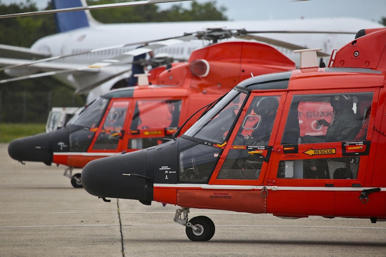 U.S. Coast Guard HH-65C Dolphin helicopters from Coast Guard Air Station Atlantic City are prepared for a mission during a three-day Aeropsace Control Alert CrossTell live-fly training exercise at Atlantic City International Airport, N.J., May 24, 2017. Representatives from the Air National Guard fighter wings, Civil Air Patrol, and U.S. Coast Guard rotary-wing air intercept units will conduct daily sorties from May 23-25 to hone their skills with tactical-level air-intercept procedures. (U.S. Air National Guard photo by Master Sgt. Matt Hecht/Released)