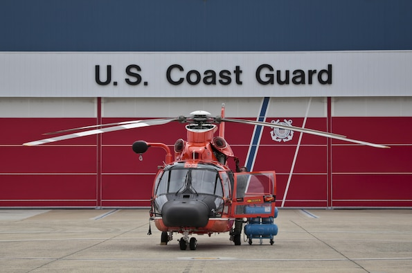 A U.S. Coast Guard HH-65C Dolphin helicopter from Coast Guard Air Station Atlantic City is prepared for a mission during a three-day Aeropsace Control Alert CrossTell live-fly training exercise at Atlantic City International Airport, N.J., May 24, 2017. Representatives from the Air National Guard fighter wings, Civil Air Patrol, and U.S. Coast Guard rotary-wing air intercept units will conduct daily sorties from May 23-25 to hone their skills with tactical-level air-intercept procedures. (U.S. Air National Guard photo by Master Sgt. Matt Hecht/Released)