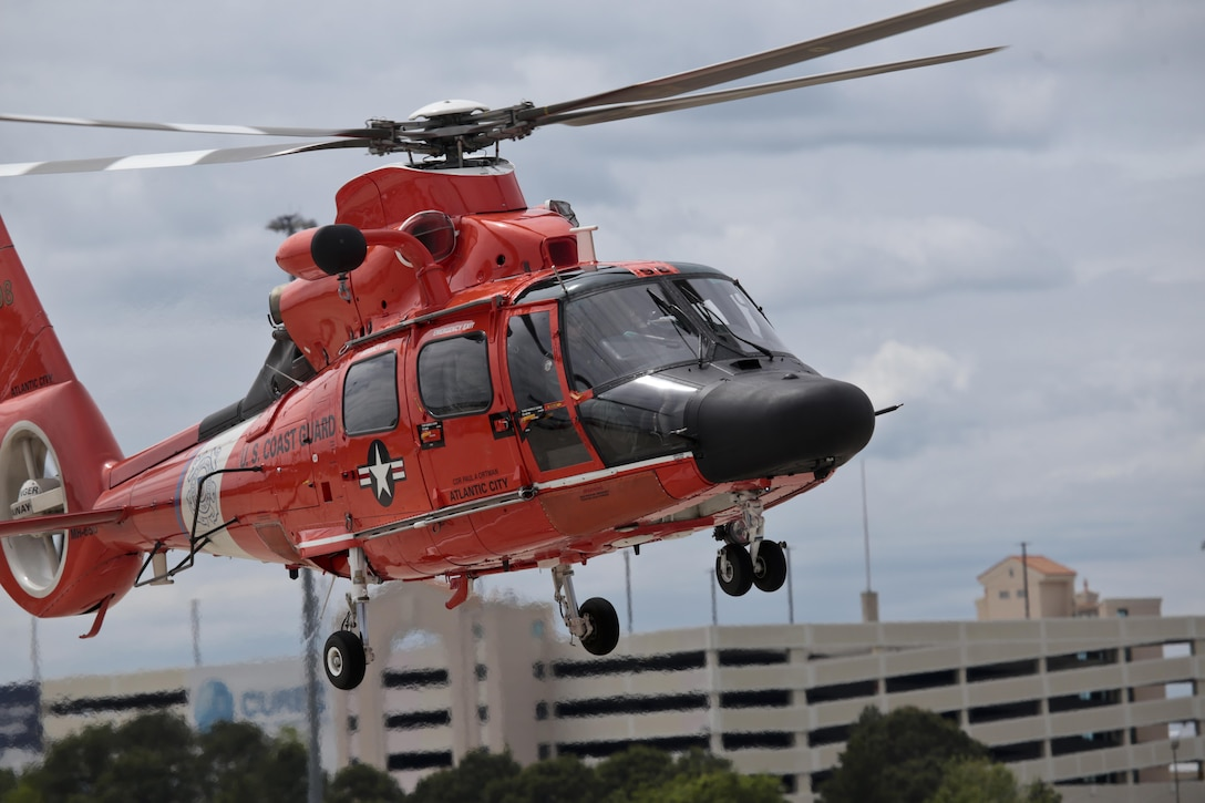 A U.S. Coast Guard HH-65C Dolphin helicopter from Coast Guard Air Station Atlantic City takes off during a three-day Aeropsace Control Alert CrossTell live-fly training exercise at Atlantic City International Airport, N.J., May 24, 2017. Representatives from the Air National Guard fighter wings, Civil Air Patrol, and U.S. Coast Guard rotary-wing air intercept units will conduct daily sorties from May 23-25 to hone their skills with tactical-level air-intercept procedures. (U.S. Air National Guard photo by Master Sgt. Matt Hecht/Released)