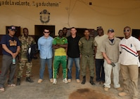 Airmen deployed to 724th Expeditionary Air Base Squadron and members of the Forces Armées Nigeriennes pose for a photo in Agadez, Niger, May 16, 2017. Firefighters from the 724th EABS visited the FAN's fire department for a joint knowledge exchange to help continue building partnerships. (U.S. Air Force photo by Senior Airman Jimmie D. Pike)