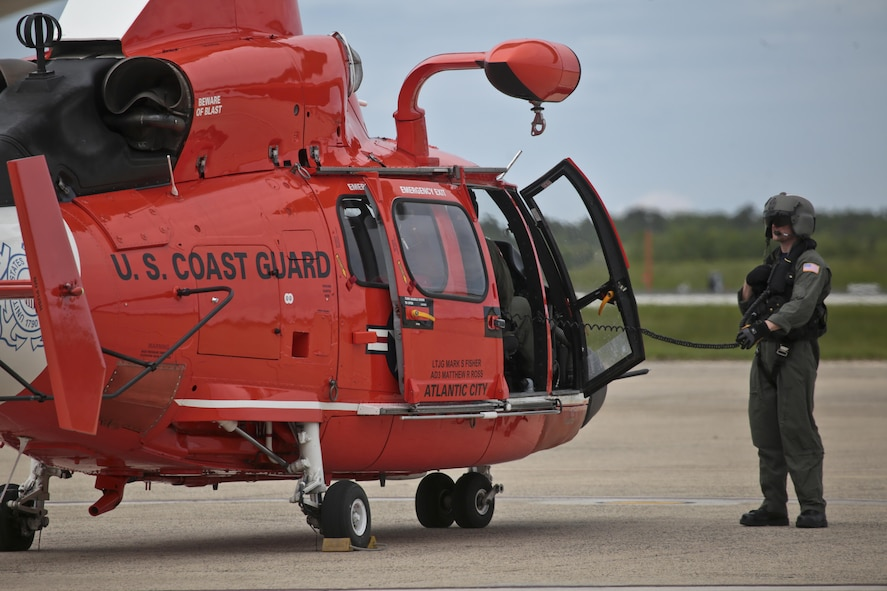 A U.S. Coast Guard HH-65C Dolphin crew chief from Coast Guard Air Station Atlantic City preps the aircraft for takeoff after an alert during a three-day Aeropsace Control Alert CrossTell live-fly training exercise at Atlantic City International Airport, N.J., May 24, 2017. Representatives from the Air National Guard fighter wings, Civil Air Patrol, and U.S. Coast Guard rotary-wing air intercept units will conduct daily sorties from May 23-25 to hone their skills with tactical-level air-intercept procedures. (U.S. Air National Guard photo by Master Sgt. Matt Hecht/Released)