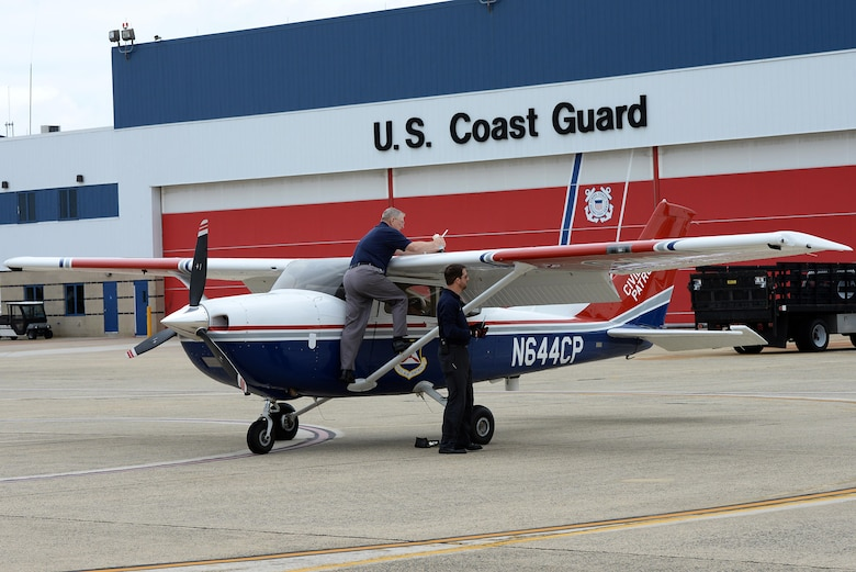 Civil Air Patrol pilots Mark Burchfield, left, and Scott Faulkner,  prepare a Cessna 182 Skylane for flight May 24, 2017, at Atlantic City International Airport, N.J. The Civil Air Patrol participated in a Cross Tell Media flight to help increase general aviation awareness. (U.S. Air National Guard photo by Airman 1st Class Cristina J. Allen/Released)