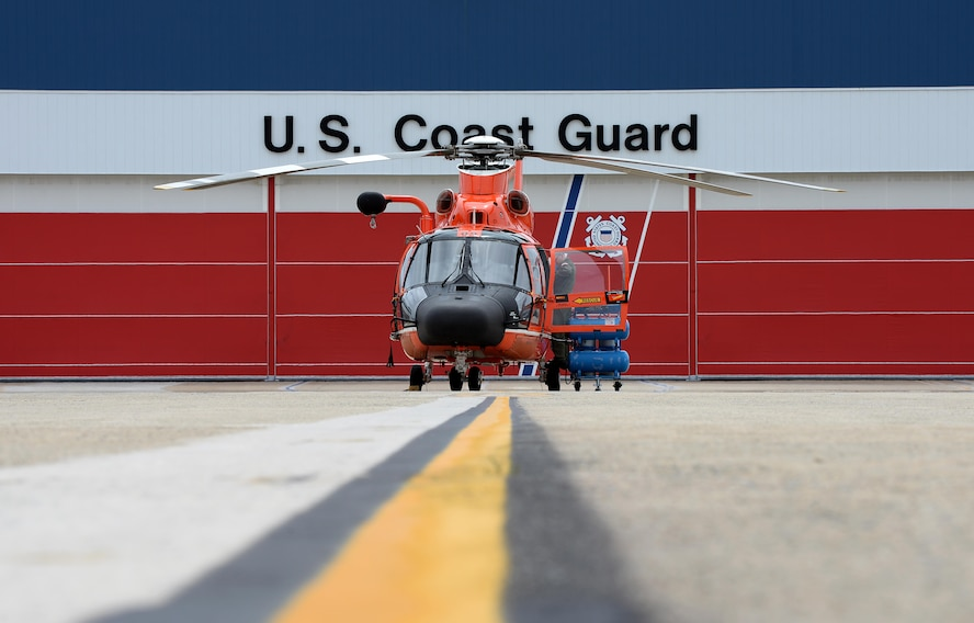 A U.S. Coast Guard HH-65C Dolphin crew member from Coast Guard Air Station Atlantic City preps his helicopter before an alert during a CrossTell training exercise at the Atlantic City International Airport, N.J., May 24, 2017. Air National units from New Jersey, South Carolina and Washington D.C. participated in training and familiarization exercises with the U.S. Coast Guard and Civil Air Patrol during the three-day CrossTell to increase awareness of the Aerospace Control Alert mission. (U.S. Air National Guard photo by Airman 1st Class Cristina J. Allen/Released)
