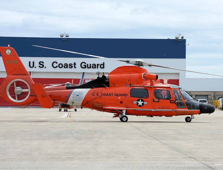 A U.S. Coast Guard HH-65C Dolphin Helicopter prepares to take off for an alert during a Cross Tell training exercise at the Atlantic City International Airport, N.J., May 24, 2017. Air National units from New Jersey, South Carolina and Washington D.C. participated in training and familiarization exercises with the U.S. Coast Guard and Civil Air Patrol during the three-day CrossTell to increase awareness of the Aerospace Control Alert mission. (U.S. Air National Guard photo by Airman 1st Class Cristina J. Allen/Released)