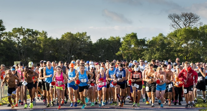 The runners take off as the 32nd annual Gate to Gate run begins at Eglin Air Force Base, Fla., May 27.  More than 900 people participated at this year's event.  (U.S. Air Force photo/Samuel King Jr.)