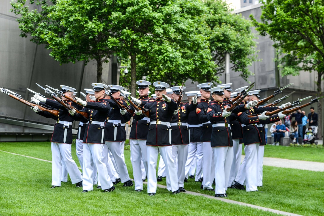 The Marine Corps Silent Drill Platoon performs for a crowd at the 9/11 Memorial Plaza