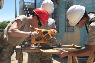 U.S. Army Soldiers from the 409th Engineer Company based out of Windsor, Colorado, cut wood to help build a wheelchair and emergency ramp in Ladyville, Belize, May 23, 2017. The Ladyville Clinic is one of three clinics being built during Beyond the Horizon 2017, a U.S. Southern Command-sponsored, Army South-led exercise designed to provide humanitarian and engineering services to communities in need, demonstrating U.S. support for Belize. (U.S. Army photo by Spc. Kelson Brooks) (RELEASED)