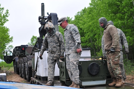 Soldiers with the 993rd Transportation Company from Palatka, Florida, unload equipment from a palletized load system during Maple Resolve 17 at Camp Wainwright, Alberta, Canada, on May 24, 2017.  The U.S. military is providing a wide array of combat and support elements for the Canadian Army's premier brigade-level validation exercise designed to enhance unit readiness and interoperability. (U.S. Army photo by Sgt. Sarah Zaler)