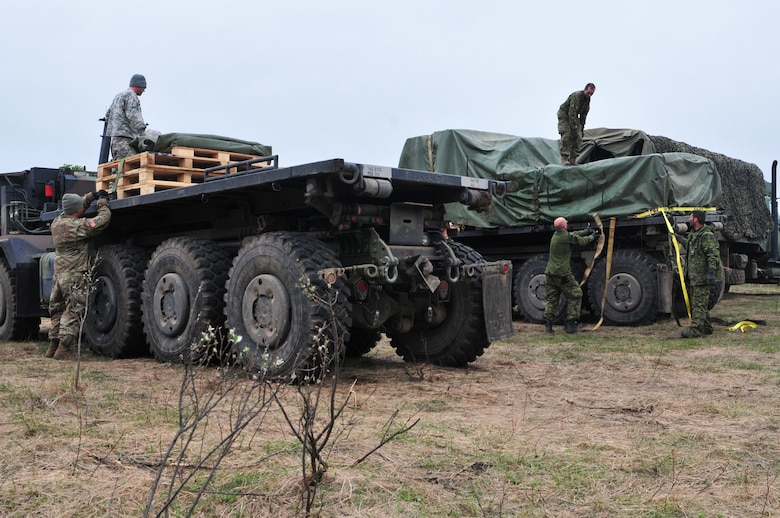 Army Reserve Soldiers with the 993rd Transportation Company from Palatka, Florida, transfer rations to Canadian troops from 2 Service Battalion during Maple Resolve 17 at Camp Wainwright, Alberta, Canada on May 24, 2017.  The U.S. military is providing a wide array of combat and support elements for the Canadian Army's premier brigade-level validation exercise designed to enhance unit readiness and interoperability. (U.S. Army photo by Sgt. Sarah Zaler)