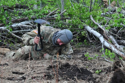 Pfc. Bradley Dodson, a maintenance mechanic from Ocala, Florida, digs a foxhole during Maple Resolve 17 at Camp Wainwright, Alberta, Canada, on May 24, 2017. Dodson's unit, the 993rd Transportation Company, provided logistical and security support during the Canadian Army's premier brigade-level validation exercise running 14-29 May.