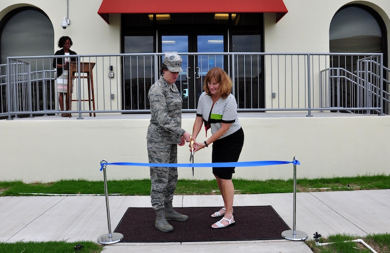 U.S. Air Force Maj. Gen. Peggy Poore, Air Force Personnel Center commander, and Kimberly Toney, AFPC executive director, perform the official ribbon cutting marking the finalization of AFPC's courtyard project May 23, 2017, at Joint Base San Antonio-Randolph, Texas. The project involved two general contractors, 32 subcontractors, and more than 71,000 man hours throughout three phases. (U.S. Air Force photo by Staff Sgt. Alexx Pons)