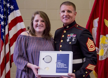 Gracyn Lasueur (left) poses for a photo with GySgt. Matthew Hoyle, the station commander for Recruiting Substation Dothan, Alabama, after being presented with the Semper Fidelis All-American award at Northview High School, May 18, 2017. LaSueur was one of 100 students who will attend the Battles Won Academy this summer in Washington D.C., where she will be given the opportunity to network with and hear from an elite circle of leaders from all walks of life, who like her, have fought and won their own battles. (U.S. Marine Corps photo by Cpl. Krista James/Released)