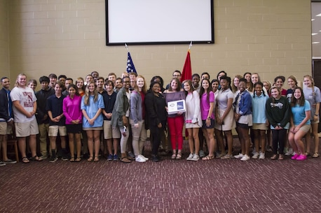 Gracyn LaSueur (center) poses with classmates and teammates after being presented the Semper Fidelis All-American award at Northview High School, May 18, 2017. LaSueur was one of 100 students who will attend the Battles Won Academy this summer in Washington D.C., where she will be given the opportunity to network with and hear from an elite circle of leaders from all walks of life, who like her, have fought and won their own battles. (U.S. Marine Corps photo by Cpl. Krista James/Released)