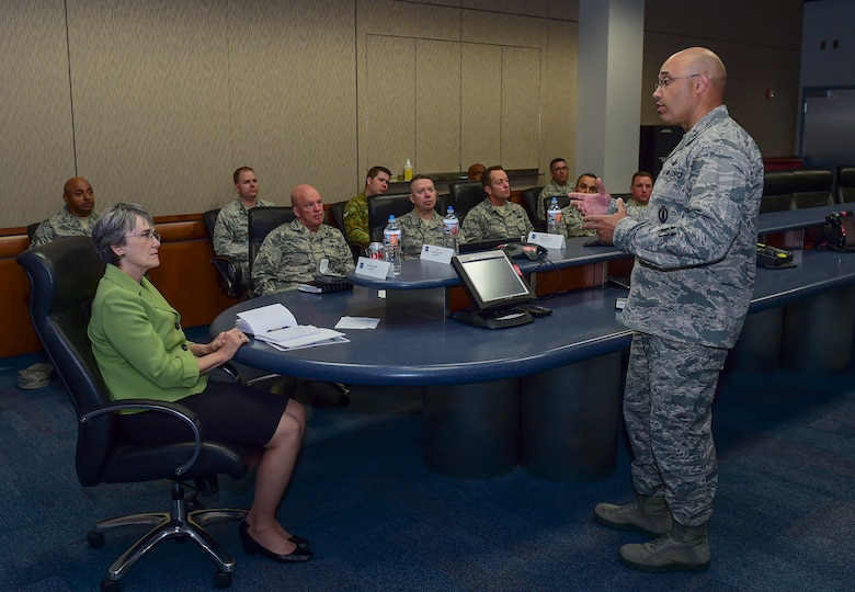 Col. David Miller, Jr., 460th Space Wing commander, briefs Secretary of the Air Force Heather Wilson, May 23, 2017, on Schriever Air Force Base, Colo. Wilson toured Schriever AFB including Buckley AFB's backup Mission Control Station, highlighting the importance of our nation's mission in space. (U.S. Air Force photo by Airman Jacob Deatherage)